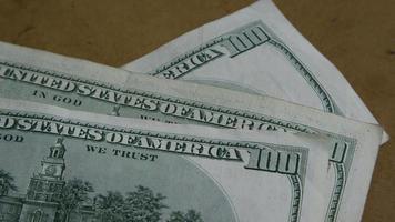 Rotating stock footage shot of $100 bills - MONEY 0151