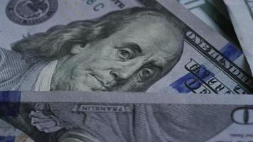 Rotating stock footage shot of $100 bills - MONEY 0141