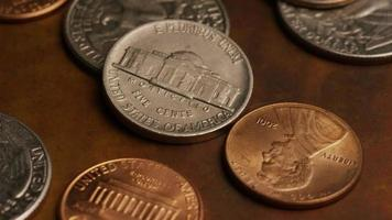 Rotating stock footage shot of American monetary coins - MONEY 0298