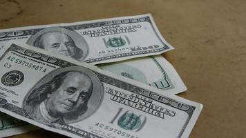 Rotating stock footage shot of $100 bills - MONEY 0146