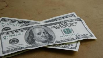 Rotating stock footage shot of $100 bills - MONEY 0145