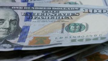 Rotating stock footage shot of $100 bills - MONEY 0129