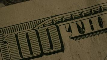 Rotating stock footage shot of American paper currency on an American eagle shield background - MONEY 0428