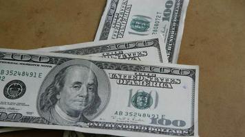 Rotating stock footage shot of $100 bills - MONEY 0149
