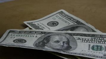 Rotating stock footage shot of $100 bills - MONEY 0157