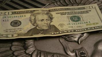 Rotating stock footage shot of American paper currency on an American eagle shield background - MONEY 0393
