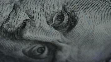 Rotating stock footage shot of $100 bills - MONEY 0128