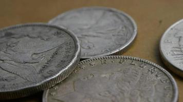 Rotating stock footage shot of antique American coins - MONEY 0090