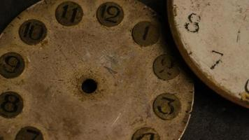 Rotating stock footage shot of antique and weathered watch faces - WATCH FACES 013