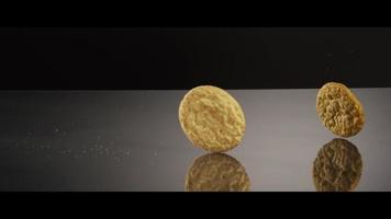 Falling cookies from above onto a reflective surface - COOKIES 218 video