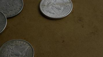 Rotating stock footage shot of antique American coins - MONEY 0062