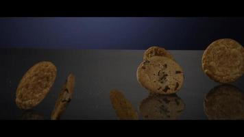 Falling cookies from above onto a reflective surface - COOKIES 247 video