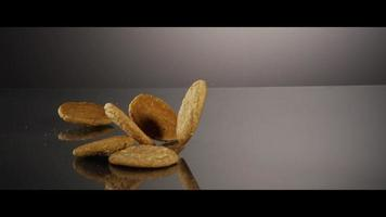 Falling cookies from above onto a reflective surface - COOKIES 227 video