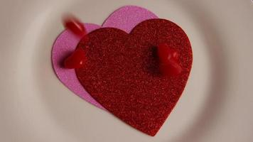 Rotating stock footage shot of Valentines decorations and candies - VALENTINES 0117