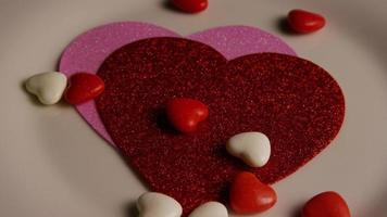 Rotating stock footage shot of Valentines decorations and candies - VALENTINES 0100