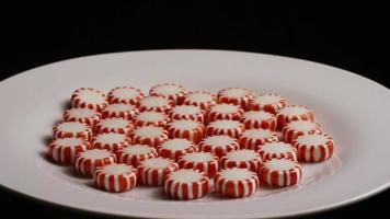 Rotating shot of peppermint candies - CANDY PEPPERMINT 040 video