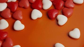 Rotating stock footage shot of Valentines decorations and candies - VALENTINES 0052