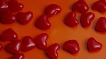 Rotating stock footage shot of Valentines decorations and candies - VALENTINES 0041 video