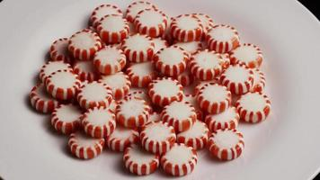 Rotating shot of peppermint candies - CANDY PEPPERMINT 058 video