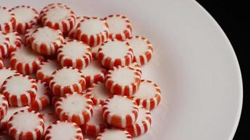 Rotating shot of peppermint candies - CANDY PEPPERMINT 059 video