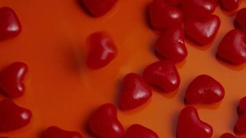 Rotating stock footage shot of Valentines decorations and candies - VALENTINES 0042 video