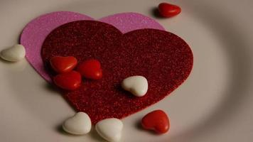 Rotating stock footage shot of Valentines decorations and candies - VALENTINES 0098 video
