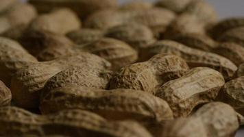 Cinematic, rotating shot of peanuts on a white surface - PEANUTS 015