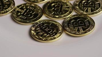 Rotating shot of Bitcoins (digital cryptocurrency) - BITCOIN 0261