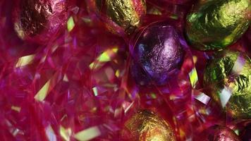 Foto giratoria de coloridos dulces de Pascua sobre un lecho de pasto de Pascua - Pascua 204