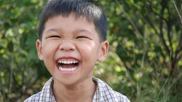 Close up little boy laughing and smile after hearing joke story