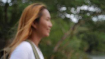 Portrait of woman traveler smiling in the nature