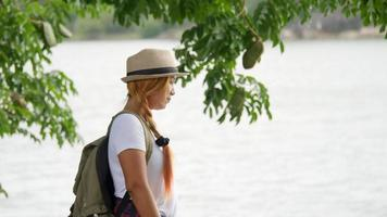 Woman with a backpack walking relax and refresh the air