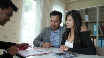 Happy couple sit talking and invest their business affairs with business planner