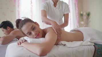 Beautiful Young Woman getting Thailand Massage