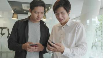 Young men using mobile phone