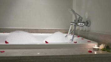 Bathtub With Rose Petals And Candle