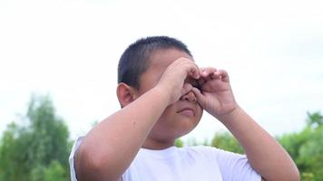 Boy Makes A Binocular With His Hands