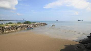 Time lapse of fishing boat on the beach with blue sky in Thailand. video
