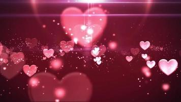 Pink blinking hearts fading and sparkling in a dark pink background