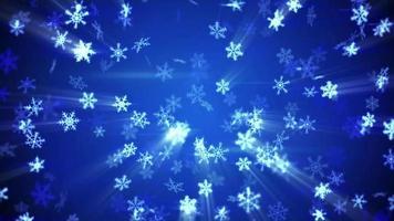 flocons de neige lumineux tombant dans un fond bleu