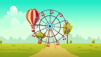 ein Riesenrad und ein Ballon