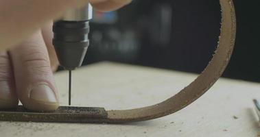 Drilling wholes in the leather