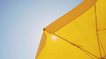 Beach umbrella blowing in the wind