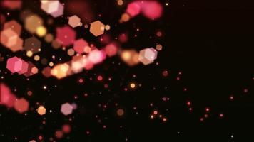 righe di luci bokeh esagonali calde che girano su sfondo scuro
