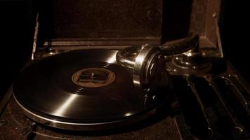 Medium shot of antique music device playing an old vynil disc in 4K