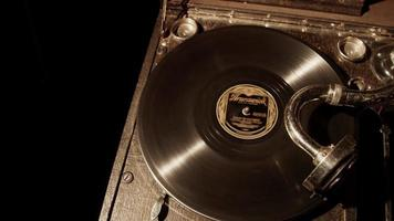 Medium panning shot top view of classic music device playing an old vynil disc in 4K