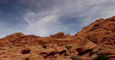 Short traveling shot of hill in desert landscape with cirrus clouds in 4K