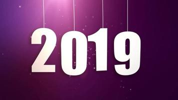 Happy New Year 2019 white paper numbers hanging on strings falling down pink background video