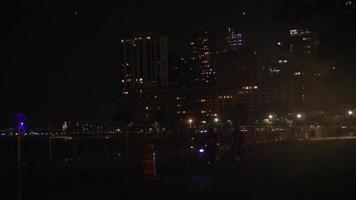 Night Shot Of Chicago City Skyline And Centennial Wheel