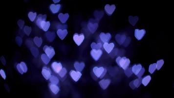 luces bokeh corazón púrpura